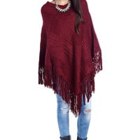 Maroon knitted poncho cape with tassel trim