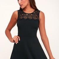 According to Love Black Lace Skater Dress