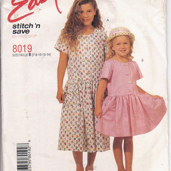 Pattern for girls drop waist dress with short sleeves and button front bodice size 7 8 10 12 14 McCalls Stitch and Save 8019 UNCUT