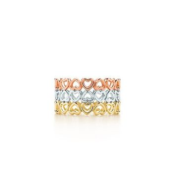 Tiffany & Co. -  Paloma's Crown of Hearts three-row ring in 18k yellow, white and rose gold.