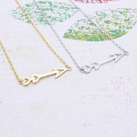Tiny heart arrow necklace in  silver or gold tone