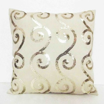 swirly pattern gold sequins on beige silk cushion in size 16x16 inches