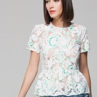 Embroidered top with peplum hem