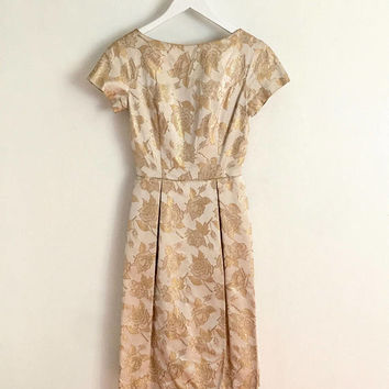 Vintage 1950s champagne satin cocktail dress with tulip shaped skirt and gold brocade roses