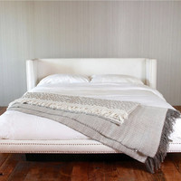 White Fabric Platform Bed With Vintage Nails
