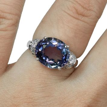 An East West 6.9CT Oval Cut Alexandrite Engagement Ring