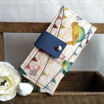 Women's handmade bifold wallet in birds on a wire print with blue contrast. Credit card slots, bill slots, coin pouch
