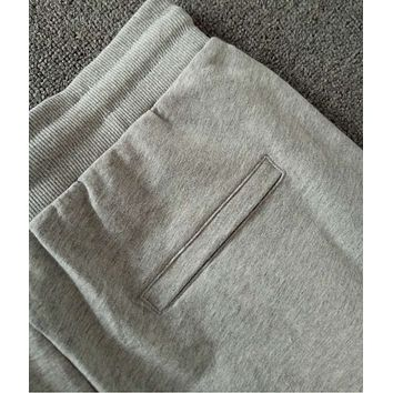 Under Armor Autumn new embroidery casual pants elastic drawstring shuttlecock sports trousers