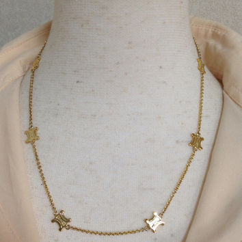 Vintage Celine goldedn skinny chain necklace with macadam blaison motif charms. Perfect classic jewelry from Celine.