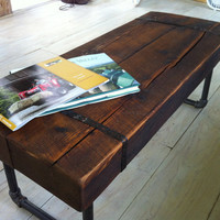 Rustic barnwood coffee table or bench with industrial pipe legs