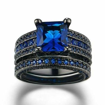 Moonlight Serenade Blue CZ and Black Gold Solitaire Engagement Ring Set