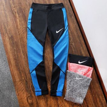 NIKE sells sports yoga leggings in color for casual women