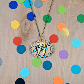 original hand painted sweet tooth on scalloped wood round necklace / 18 in brass chain
