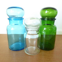Three bubble top apothecary jars in green, white and blue, made in Beligum