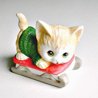 Enesco Cat Sledding Figurine 1985 Christmas Decoration Green Eyes and Sweater Kitty Cat