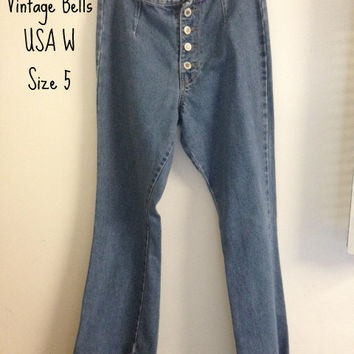 Vintage Size 5 Bell Bottoms. High Waisted Flare Jeans. Buttons up in front.  70's style. Very Unique pair of jeans.  Womens Usa 5.
