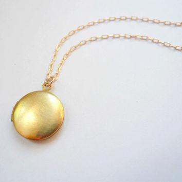 Small gold locket necklace on 14K gold fill GF chain. Dainty jewelry. Vintage round brass locket on short necklace chain.