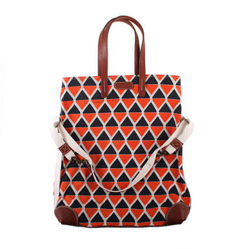 Workhorse bag in dark navy and coral 'owl' print fabric with leather handles and base