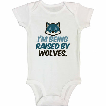 I'm Being Raised By Wolves. - Newborn Baby Bodysuits