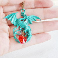 dragon necklace,flying dragon pendant,game piece dragon,lord of the ring,mythical creature,patina verdigris dragon jewelry,dragon red heart