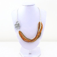 Autumn bead and chain necklace , gold bronze pearl orange seed beads , side fastening with leaf t-bar necklace.