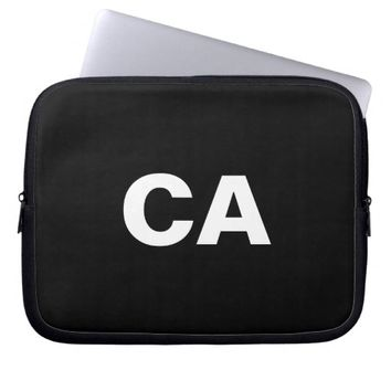 Monogrammed white big bold block letters on black computer sleeves