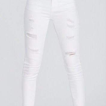 All Torn Up White Skinnies