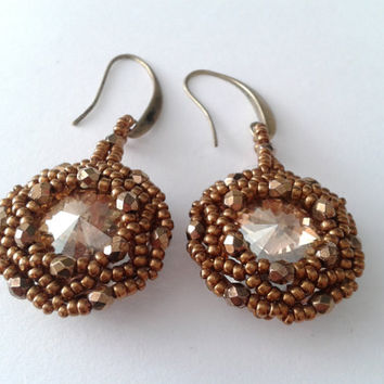 Earrings  handmade with Swarovski Rivoli of  18 mm and glass  polish faceted round beads