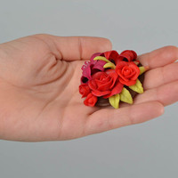 Red handmade brooch made of polymer clay in the form of flowers stylish jewelry