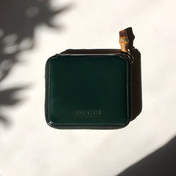 GUCCI!!! Vintage 1990s 'Gucci' green patent leather, bi-fold wallet with bamboo zip pull.