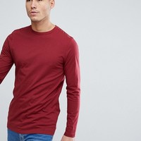 ASOS Longline Crew Neck T-Shirt With Long Sleeves In Red at asos.com