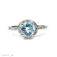 Sky Blue Topaz and White Sapphire Halo Ring