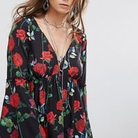 Kiss The Sky Swing Dress With Flared Sleeves And Tie Back In Floral Print at asos.com