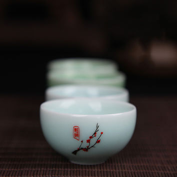 2 piece set Chinese Longquan Celadon bowl with Plum Blossom to accessorize.