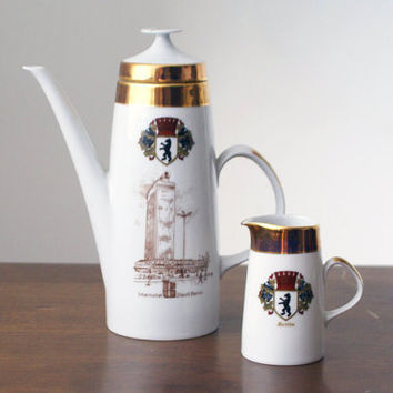 Vintage German (GDR) porcelain teapot and creamer set from the 1970s, with gold decorations and Bavarian insignia