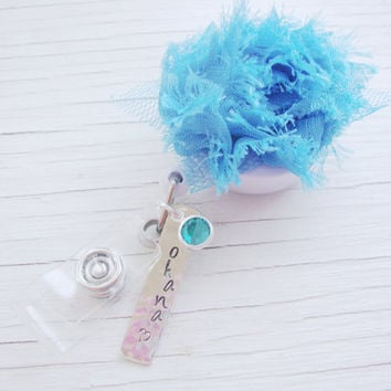 Ohana turquoise flower retractable badge holder with teal crystal charm and silver rectangle hand stamped and hammered