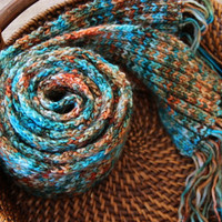 Hand knit women's scarf, long scarf with fringe. Ribbed scarf knit in turquoise and rust hand painted yarn. 100 percent merino wool.