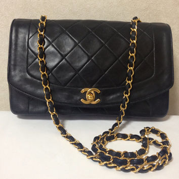 Vintage CHANEL black color lambskin classic 2.55 shoulder purse with gold tone chain straps. Make you even more chic.
