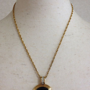Vintage LANVIN golden chain skinny necklace with oval black glass stone shape logo charm with crystals pendant top. Perfect jewelry gift.
