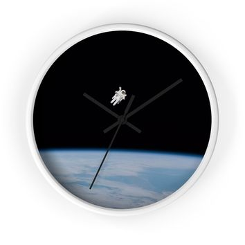 Astronaut Drifting in Space Wall clock