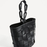 GEOMETRIC BUCKET BAG WITH BRAIDED HANDLE DETAILS
