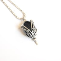 Onyx pendant, wire wrapped, oxidized sterling silver