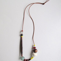 Asymmetrical beaded necklace with Native American glass beads geometric African horn and glass beads and Indian wood beads Summer fashion