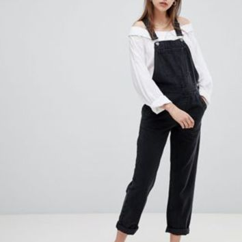 ASOS DESIGN denim dungaree in washed black at asos.com