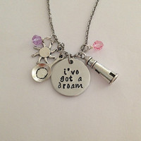 "Disney inspired Tangled necklace ""i've got a dream"" Rapunzel hand stamped swarovski crystals tower, frying pan and sun charms"