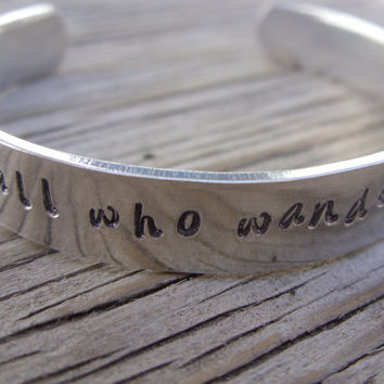 Aluminum bracelet hand stamped with -not all who wander are lost- ready to ship
