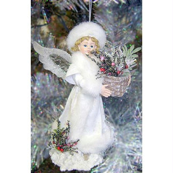 Story Teller Angel - Angel Holds A Basket Filled With A Green Christmas Plant With Red Berries