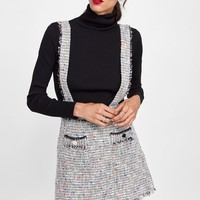 MINI SKIRT WITH TWEED SUSPENDERS DETAILS