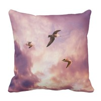 Seagulls flying in a sunset sky cushion