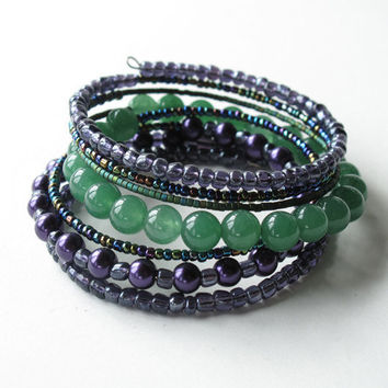 Beaded bracelet - stacking bangles - 7 coils of shimmering purple, blue & green